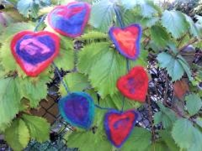Janet -- wet felted hearts in the window