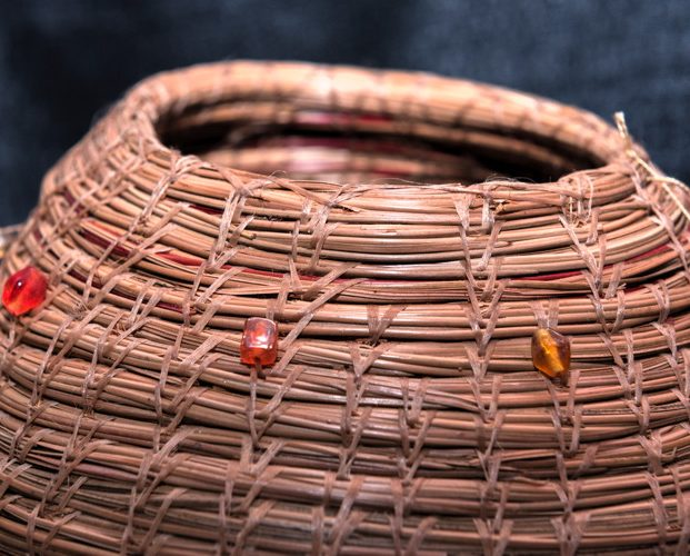 Pine needle basket decorated with beads