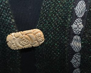 woven jacket with carved pin